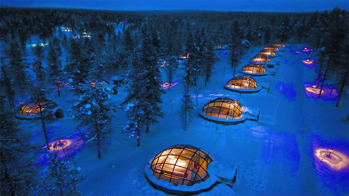 For the ultimate in cold-weather accommodations, Kakslauttanen offers a variety of options, from an earth lodge wedding chamber, several log chalets, igloos (glass or ice), and even Santa's house. Some chalets have an attached glass igloo so couples can watch the stunning aurora borealis (northern lights) right from their cozy bed.